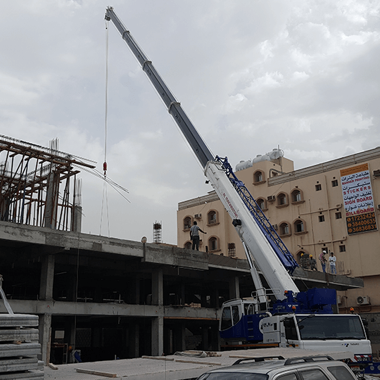 Precaste Concrete slabs being lowered into place by a crane