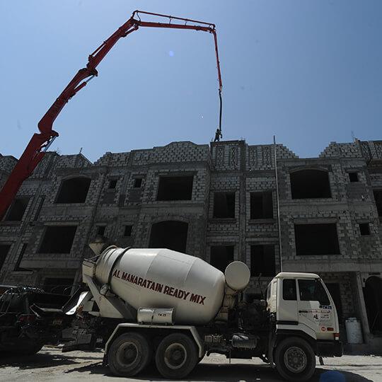 Al Manaratain Ready-Mix Concrete Truck Delivering To A Building Site