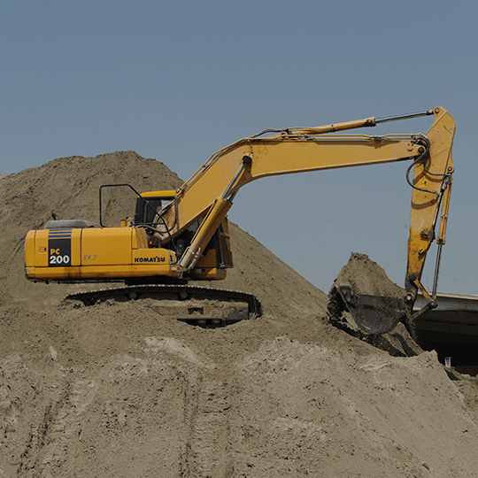 Washed Sand being picked up by a digger