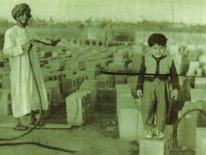 Old Photo Of Misan Al-Khamiri Standing On A Concrete Block As A Child