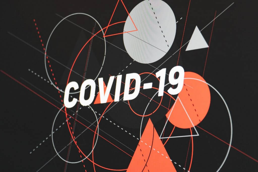 'COVID-19' written on an Illustrated background